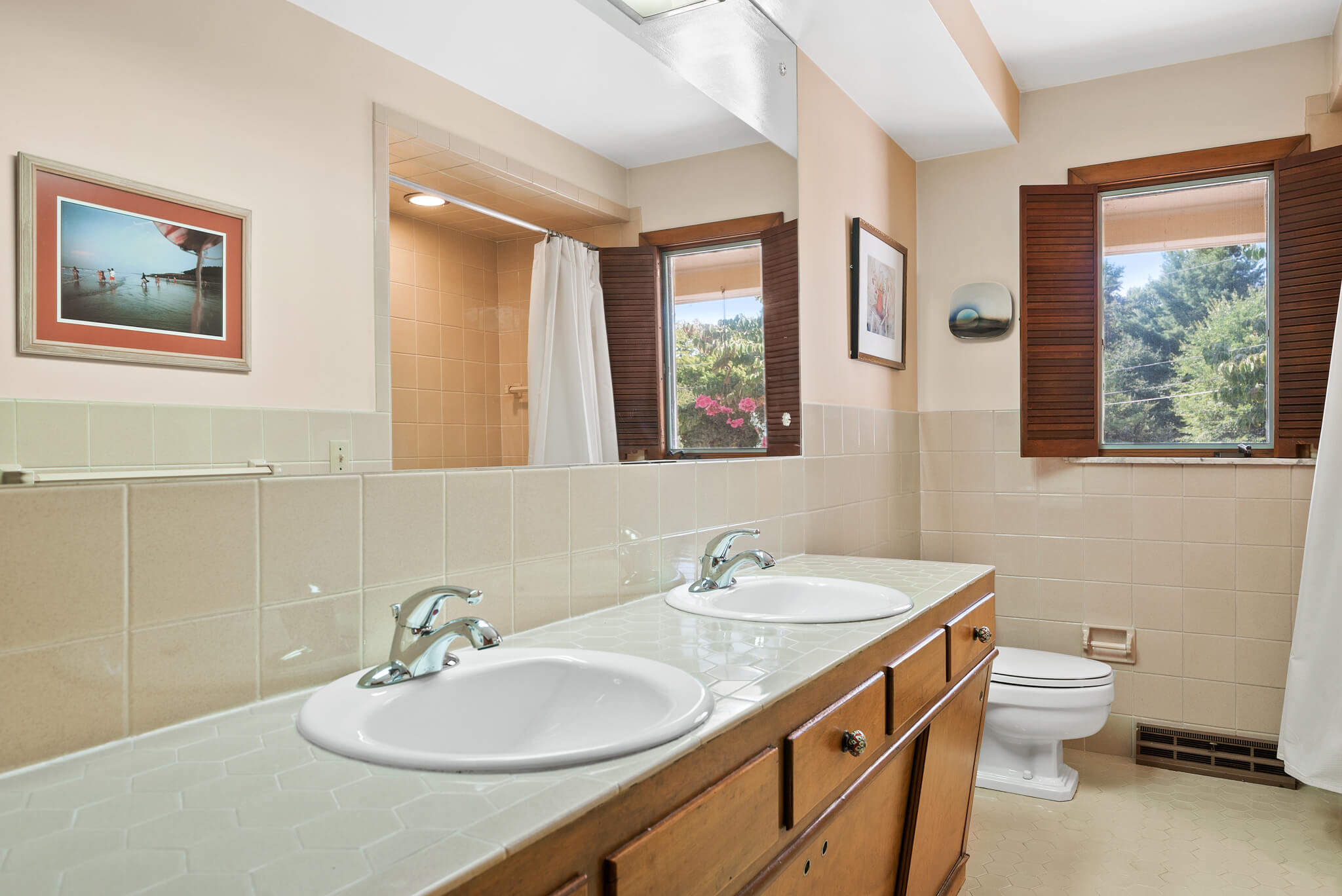 The guest bathroom with tile countertops