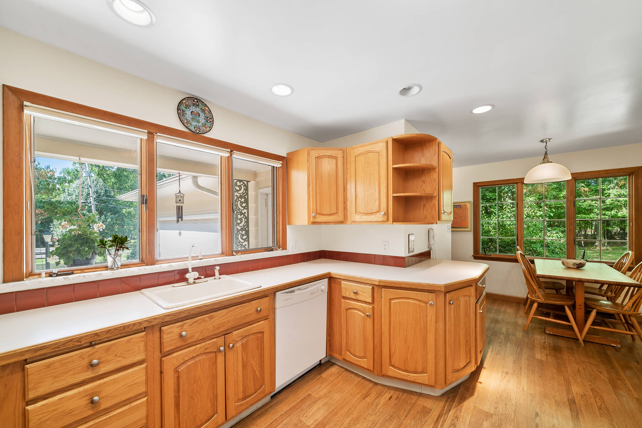 Oak cabinetry and abundant light at 4349 Orandale Dr in Chagrin Falls