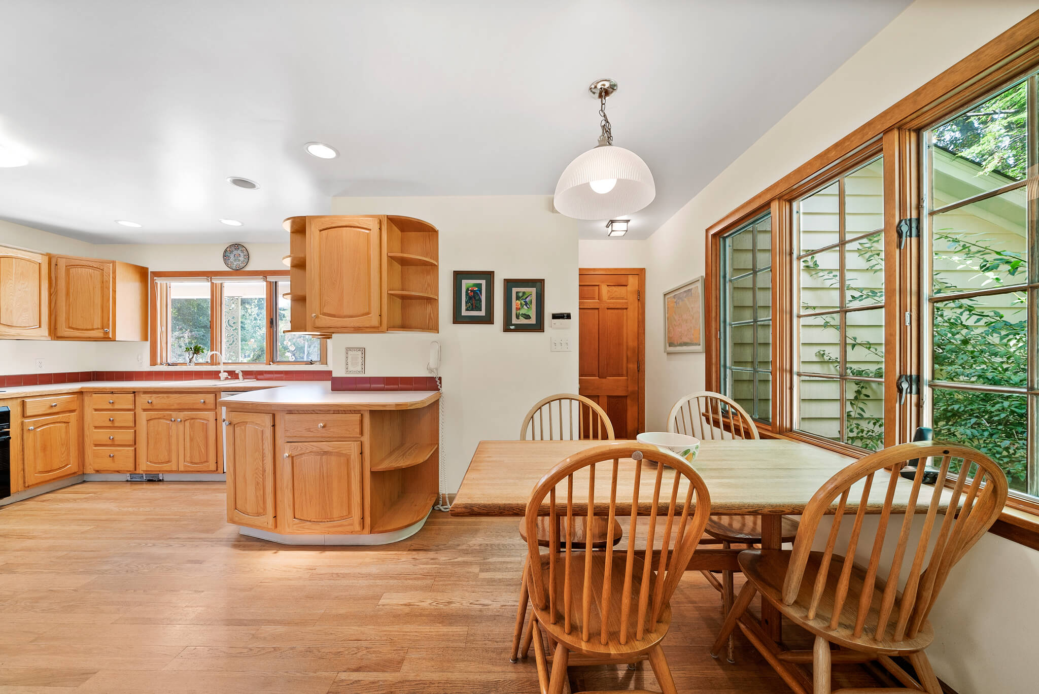 Oak cabinetry and real hardwood floors